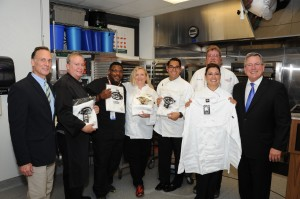 PRESS RELEASE.....High School Culinary Students Go Back to School in Style Courtesy of Texas Restaurant Association-TRA Education Foundation and Dickies Williamson-Dickie Mfg. Co. Donates 17,000 Chef Coats to Students in Texas ProStart Programs.           Press conference to announce the Texas Restaurant AssociationÕs (TRA) philanthropic foundation, the TRA Education FoundationÕs partnership with Williamson-Dickie Mfg. Co. to donate $350,000 in Dickies chef coats to high school students enrolled in 220 Texas ProStart culinary arts and restaurant management programs across the state. In attendance were The Honorable Charlie Geren, Texas House of Representatives; President, Railhead Smokehouse Restaurant Michael Penn, Senior Vice President International Sales & Licensing, Williamson-Dickie Mfg. Co. Richie Jackson, CEO, Texas Restaurant Association Chef Timothy Kelly, Career & Technical Education Coordinator, Fort Worth ISD; TRA Education Foundation Board of Trustees member E. Omar Ramos, Principal, Trimble Technical High School, Fort Worth. The event was photographed Friday, August 28, 2015 at Trimble Technical High School. Photography by Bruce E. Maxwell.